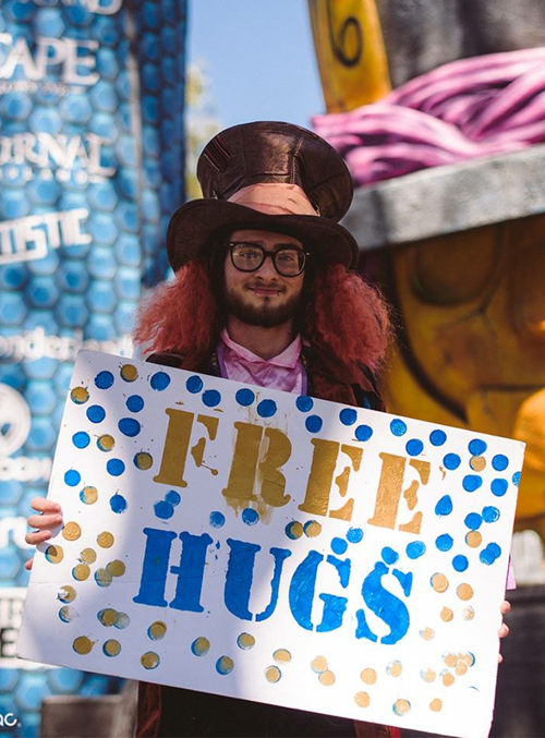 Featured on Insomniac's page – obligatory FREE HUGS poster